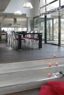 réalisation d'un escalier en béton ciré dans un salon à Strasbourg Petit futé Immobilier